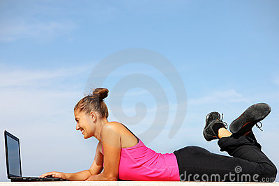 Fit woman working on computer