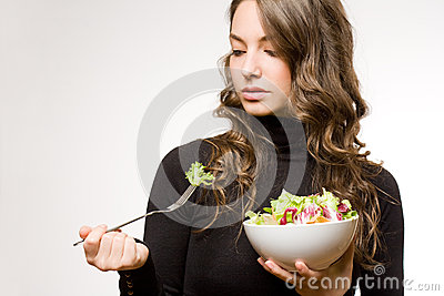Fit young brunette with salad.