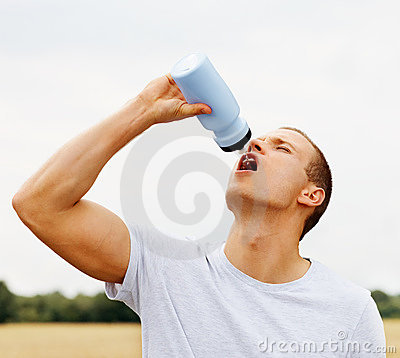 Fit young guy drinking water from a drink bottle