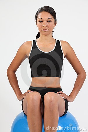Fit young woman concentrating on balance exercise