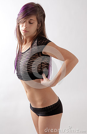 Fit Young Woman Undressing