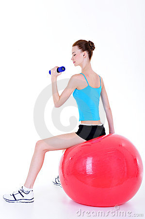 Fitball and doing exercise with dumbbells
