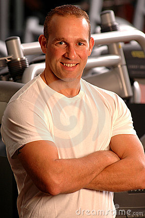 Fitness center fit man smiling