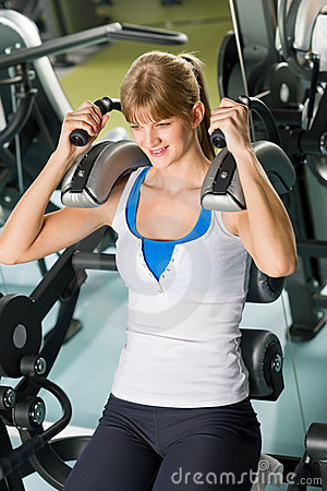 Fitness center young woman exercise abdominal