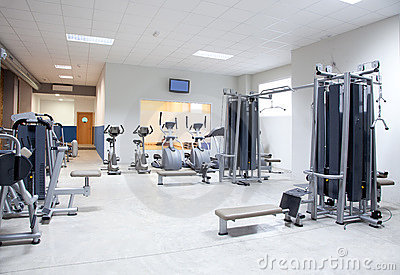 Fitness club gym with sport equipment interior