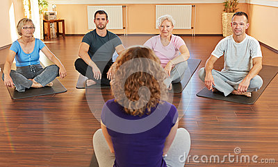 Fitness coach giving yoga