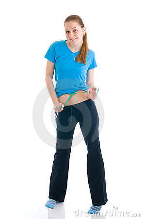 Fitness concept: the girl with centimeter