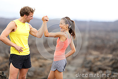 Fitness couple celebrating cheerful and happy
