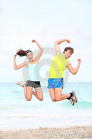 Free Fitness Couple Jumping Fun Stock Photo - 24186100