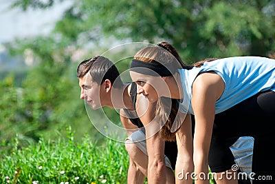 Fitness couple ready to start running