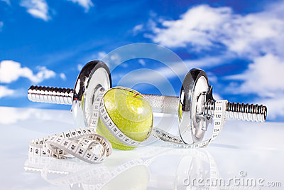 Fitness dumbbells and apple