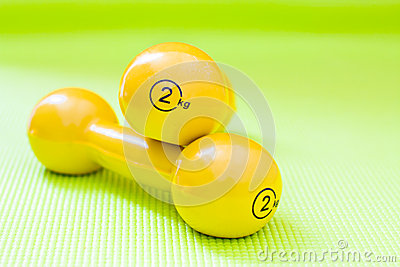 Set of dumbbells on yoga mat