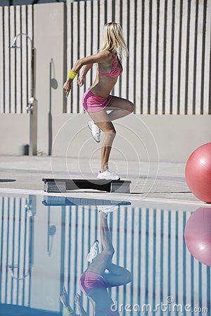 Fitness exercise at poolside