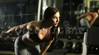 Fitness girl in the gym. Train triceps stock video