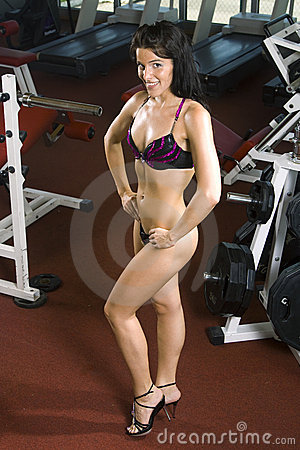 Fitness girl posing at the gym