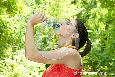 Fitness girl refreshing