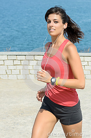 Fitness girl running on summer