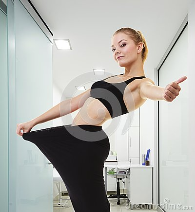 Free Fitness Girl Showing How Much Weight She Lost  Giving Thumb Up Royalty Free Stock Images - 38498789