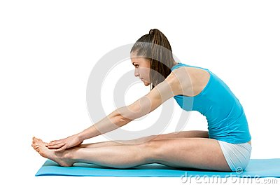 Fitness girl touching toes.