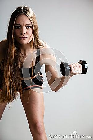 Fitness girl training shoulder muscles lifting dumbbells Stock Photo