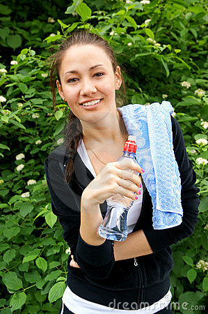 Fitness girl with water and towel