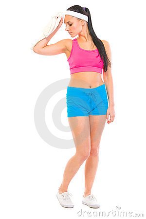 Fitness girl wiping with towel