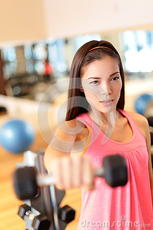 Fitness gym woman strength training lifting weights