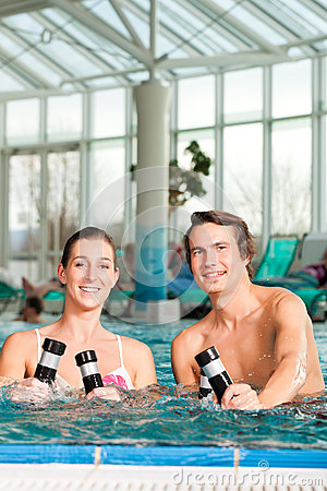 Free Fitness - Gymnastics Under Water In Swimming Pool Stock Images - 32481344