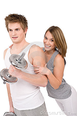 Fitness - healthy couple exercising with weights