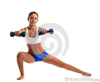 Fitness instructor doing split with dumbbells