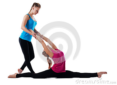 Fitness instructor help woman doing yoga asana