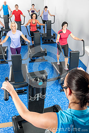 Fitness instructor leading treadmill running class