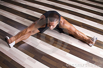 Fitness instructor streching his legs