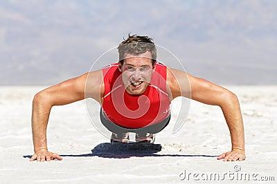 Fitness man doing push ups training outdoor