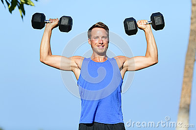 Fitness man dumbbell weights training outside