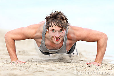 Fitness man exercising push ups