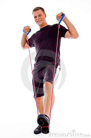 Fitness man posing with stretching rope