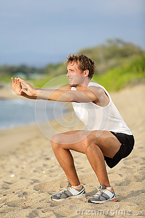 Free Fitness Man Training Air Squat Exercise On Beach Royalty Free Stock Photo - 30674495