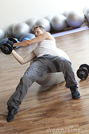 Fitness program, weight lifting on stability ball