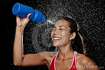 Fitness runner woman drinking