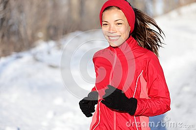 Fitness running woman in winter