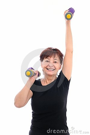 Fitness senior woman with barbells