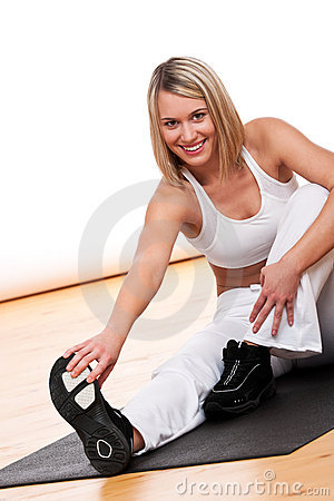 Fitness series - Blond woman exercising on mat