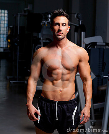 Fitness shaped muscle man posing on gym