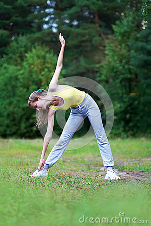 Fitness, sport, exercise concept - woman doing exercises