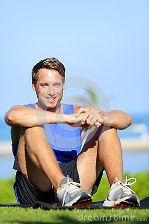 Fitness sports athlete man relaxing after training