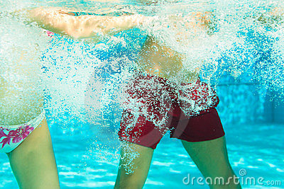 Fitness - sports under water in swimming pool