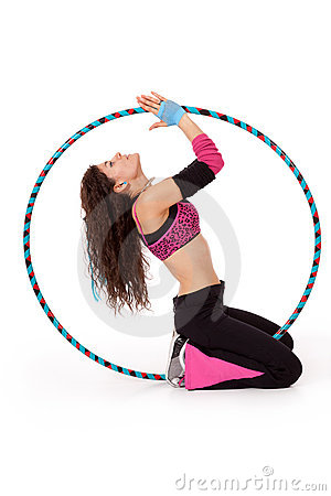 Fitness teacher posing in hula hoop
