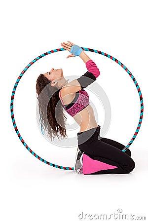 Fitness teacher posing in hula hoop