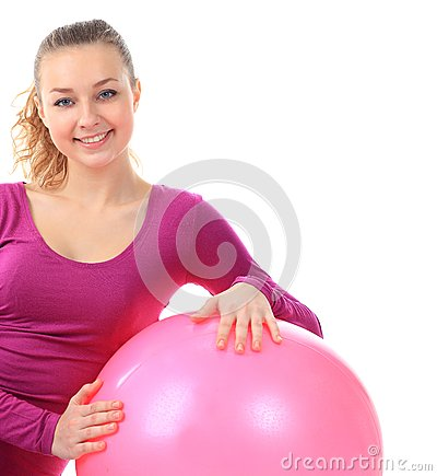 Fitness woman  with ball smiling joyful and happy, isolated on w